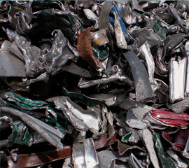 Scraps of lacquered aluminium